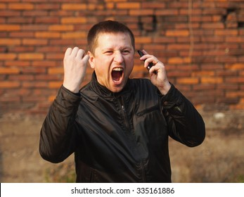 Anger - man with a cell phone yelling
