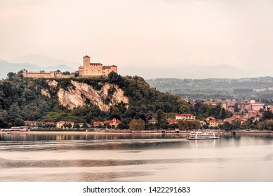 Angera Castle and Lake Maggiore from Arona in a cloudy day