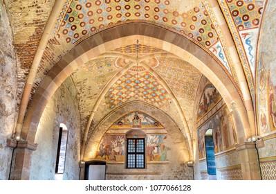 Angera, Italy - April 20, 2018: Interiors of Fortress Borromeo of Angera or Rocca di Anger, the Hall of Justice - Sala della Giustizia. Is Castle of the lake Maggiore in Angera.