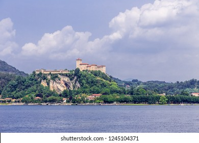 Angera, Italy, July 12, 2013: View of the fortress Rocca of Angera from Arona across Lake Maggiore.