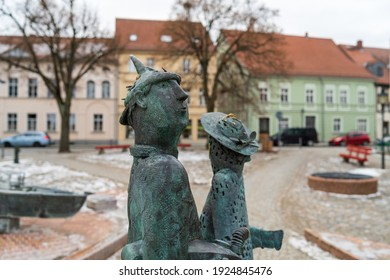ANGERMUENDE, GERMANY - FEBRUAR 06, 2021: Sculptures of a man and a woman on a market square in the center of an old medieval town in the district of Uckermark in the state of Brandenburg.
