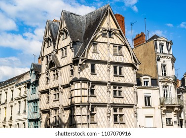 Angers, France: Adam's House (Maison d'Adam)  is the oldest house of Angers, a half-timbered building built around the year 1500. The facade is beautifully decorated with wooden sculptures.