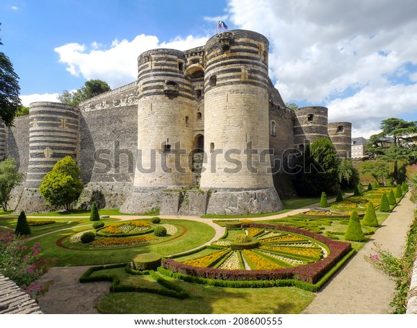 Angers, France - June 10, 2014: Chateau d'Angers. View of the walls of the castle and gardens around