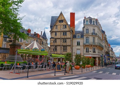 Angers, France - May 7, 2012: Adam house in Place Sainte-Croix Square in the city center of Angers in Maine et Loire department of Pays de la Loire, Lire Valley, in France. People on the background
