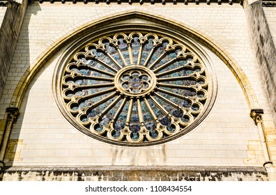 Angers, France: Rose window on the side of St. Maurice Cathedral of Angers, built between the 11th and 16th centuries, classified in 1862 as a national monument.
