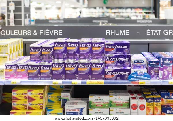 Angers, Maine et Loire / France - June 05 2019: pharmacy shelves, flu medicine, epidemic