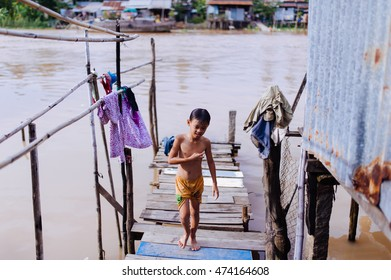 AnGiang, Vietnam - Aug 17, 2016: the boy are moving on the bridge after a cold shower on the edge of the river, the Mekong River, flows through the province AnGiang.