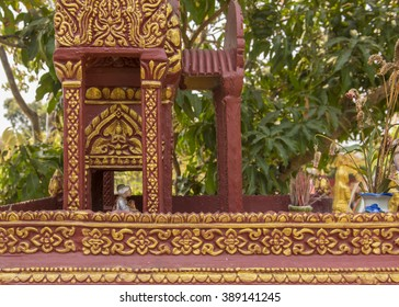 Angkhor, Cambodia - January 30 2016:  Many houses and shops have a house shrine with small figures of the ancestors and offerings to keep the spirits safe and placated