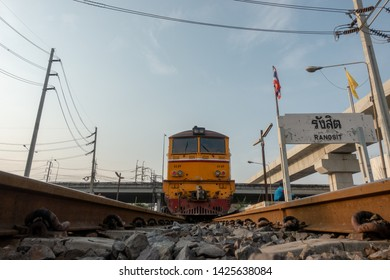 ANGKOK , THAILAND- March 09,2019: The train is led by diesel locomotives, electric yellow, train tracks, trains that are ready for departure at the train station. Bangkok, Thailand