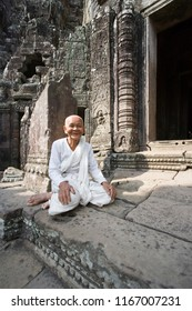 Angkor. Cambodia. 05.14.06. Buddhist Nun at the Bayon Temple in Angkor Wat in Cambodia. This is a UNESCO World Heritage Site.