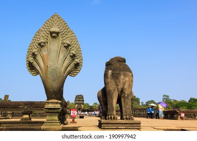 ANGKOR, CAMBODIA - APR 07: The statue of naga snake and lion without head at the entry into Angkor Wat. On Apr 7, 2014.