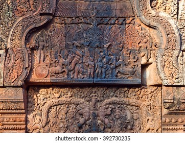 ANGKOR, CAMBODIA - JANUARY 5, 2013: Ancient bas-relief at the facade of Banteay Srey Temple in Angkor Area, Cambodia. Banteay Srey is a 10th century Cambodian temple dedicated to the God Shiva.