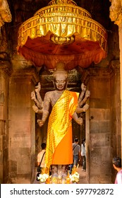 ANGKOR, SIEM REAP PROVINCE, CAMBODIA - SEP 27, 2014: Buddha statue in the Angkor Wat, the largest religious monument in the world, UNESCO World Heritage