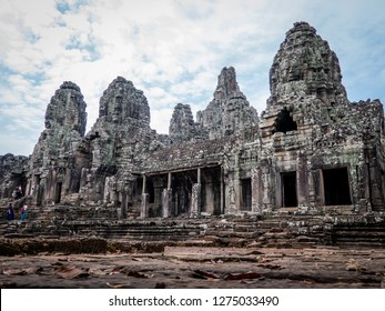 angkor thom, cambodia - november 28, 2018: bayon temple with 54 towers, each displaying 4 smiling faces of the bodhisattva avalokiteshvara.
