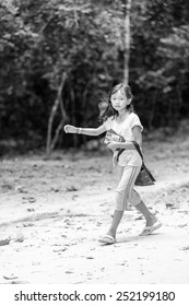 ANGKOR THOM, CAMBODIA - SEP 27, 2014: Unidentified girl at one of the temples of the Angkor Thom. Angkor Thom was the last capital city of the Khmer empire