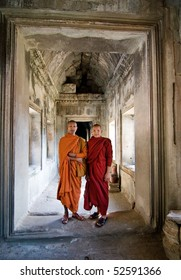 ANGKOR WAT, CAMBODIA - DECEMBER 27: Two young Buddhist priests in a hallway inside the Angkor Wat complex, December 27, 2007 in Angkor Wat, Cambodia.