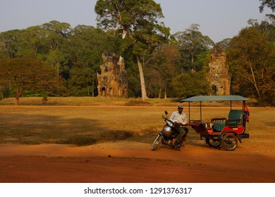ANGKOR WAT, CAMBODIA - FEB 13, 2015 - Tuk tuk driver waits for his clients, near the Elephant Terrace  of Angkor Thom,  Siem Reap, Cambodia
