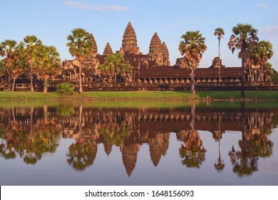 Angkor Wat, in Cambodia. Front general view of western facade at sunset with reflections. Angkor Wat is the largest religious monument in the world, and has been declared World Heritage by UNESCO.