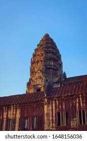 Angkor Wat, in Cambodia. Low angle view of one of the central towers at sunset. Angkor Wat is the largest religious monument in the world, and has been declared World Heritage Site by UNESCO