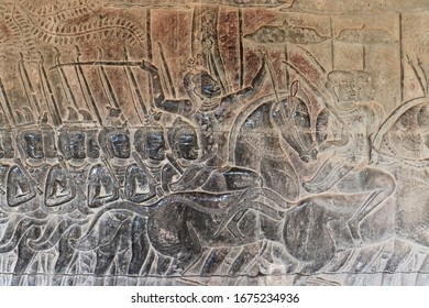 Angkor Wat is a the famous temple complex at Angkor, Cambodia, built for the king Suryavarman II as his state temple and capital city. Bas-relief carving mural on wall Angkor Wat temple.