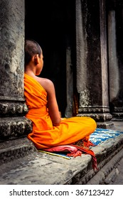 Angkor Wat monk. Ta Prohm Khmer ancient Buddhist temple in Cambo