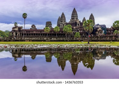 Angkor Wat reflection of the main temple in the lake at sunrise, cloudy day, Cambodia
