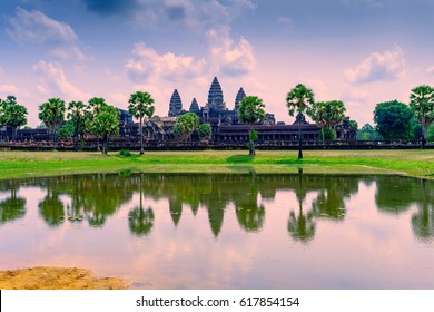 Angkor Wat with reflection on water at morning, Cambodia