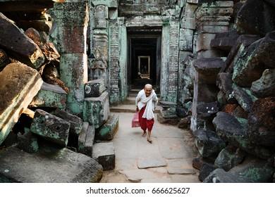 ANGKOR WAT, SIEM REAP, CAMBODIA - June 12, 2017: Portrait of an elderly Buddhist nun in the temple of Preah Khan