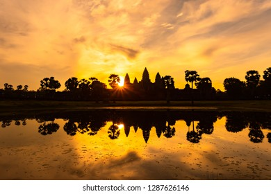 Angkor Wat Sunrise, Siem Reap, Cambodia. The Quintessential photo of religious building is from the reflection ponds in front of the temple. to see the orange light rise over this amazing temple.