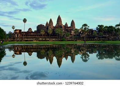 The Angkor Wat at the sunrise. Angkor Wat is a temple complex in Cambodia.Originally constructed as a Hindu god Vishnu temple for the Khmer Empire it transformed into a Buddhist temple in 12th Century