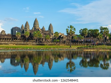 Angkor Wat temple in Cambodia with water reflection at blue sky