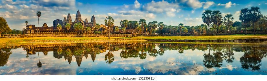 Angkor Wat temple reflecting in water of  Lotus pond at sunset. Siem Reap. Cambodia. Panorama