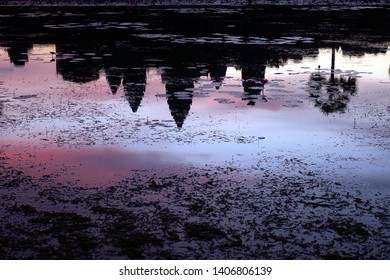 Angkor Wat temple with reflection in water at sunrise, Siem Reap Cambodia