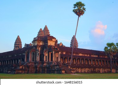 Angkor Wat temple at sunset. Exterior view of the northwest corner. Angkor Wat is the largest religious monument in the world, and has been declared World Heritage Site by UNESCO in 1992.