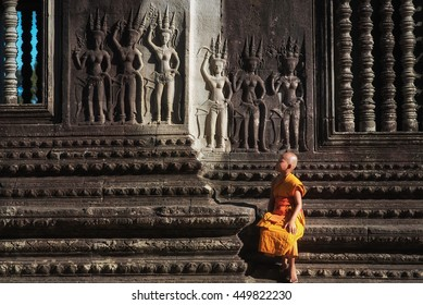Angkor Wat young buddhist monk. Famous landmark, place of worship and popular tourist travel destination in Asia.