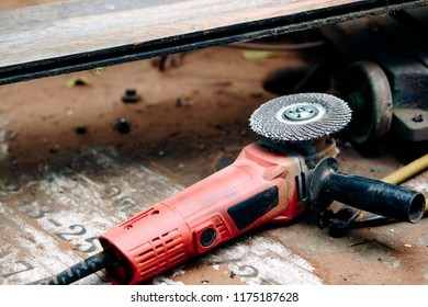 angle grinder on wood table with wood wall