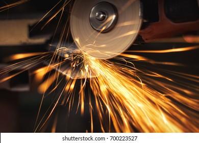 angle grinder throwing sparks.