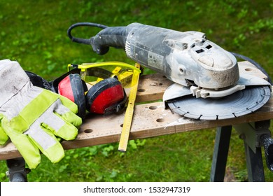 Angle grinder with workbench as background