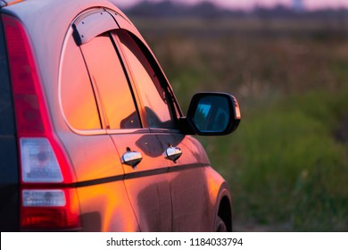 Angle shot of a car against sunset in the background
