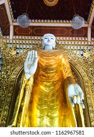 angle shot of golden Buddha statue at Burmanese temple in Penang, Malaysia