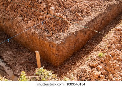 angle of the trench dug by hand under the Foundation or for laying drainage and lines drawn from a rope for evenness