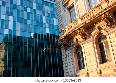 Angle of view between an old building and a modern building with sunset. Next to the congress column. Belgium, Bruxelles.