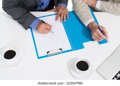 Angle view of business people developing the strategy of the company