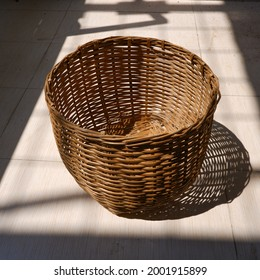 Angle view of Indonesian native planter basket made from woven bamboo under the sunlight. Handmade DIY planter basket craft.