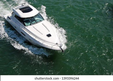 Angled overhead view of a high-end cabin cruiser on the Florida Intra-Coastal Waterway off Miami Beach