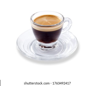 Angled view of a modern glass expresso cup and saucer full of smooth expresso coffee, isolated on white with a slight drop shadow