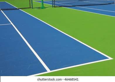 Angled View of Outdoor Tennis Court in Florida Resort Community