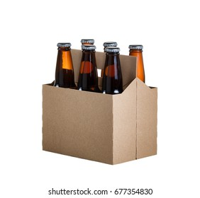 Angled view of a six pack of glass bottled beer in generic brown cardboard carrier isolated on white background