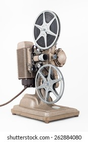 Angled view of Vintage 8 mm Movie Projector with Reels. Film is threaded through Projector.
