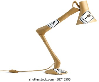 an anglepoise lamp wrapped up in brown paper, moving house/ office
